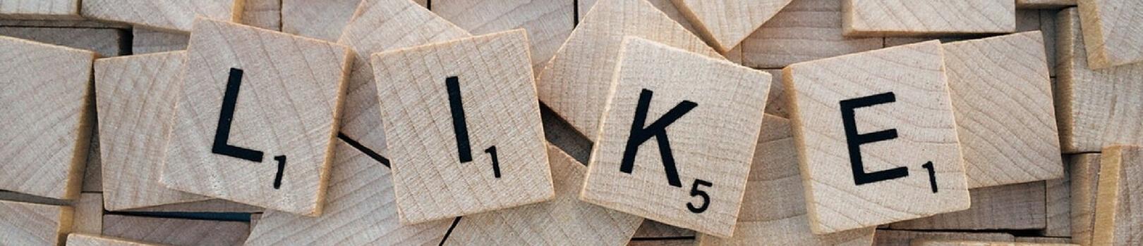 scrabble tiles spelling the word LIKE
