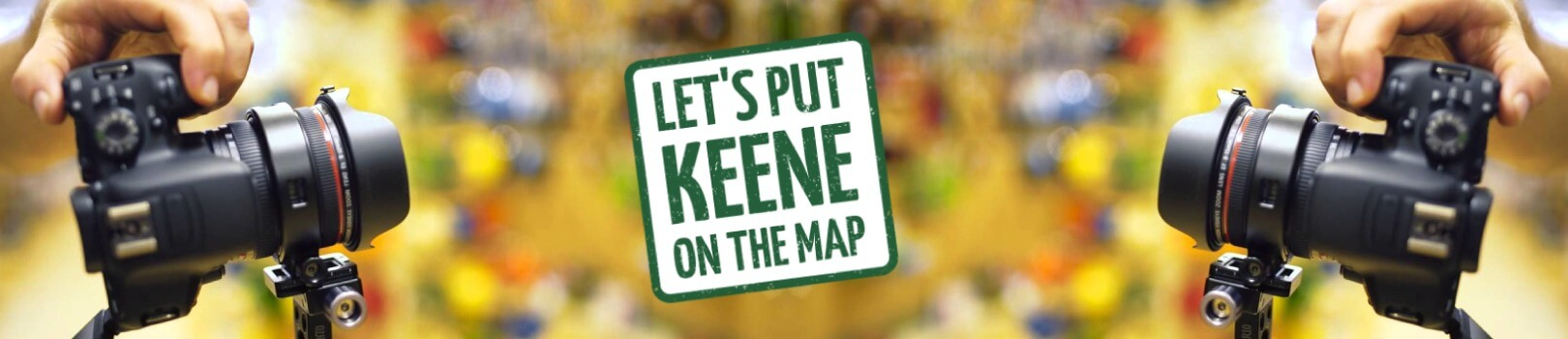 sign that says let's put keene on the map