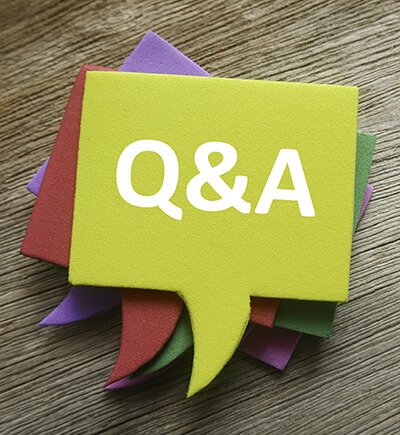 stack of colorful comment bubble notes with Q&A on top of wooden table